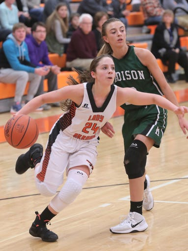 Ashland's Alyssa Steury dribbles the ball while playing