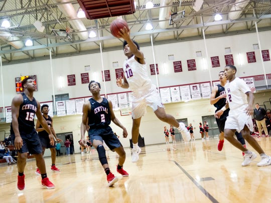 Oak Ridge's Herbert Booker (10) goes for a layup during