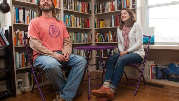 Project Grows executive director Ryan Blosser, left, and Jenna Clarke, director of operations, sit inside Stone Soup Books in Waynesboro on Tuesday, Feb. 24, 2015. Project Grows is poised to take over the book store's space.