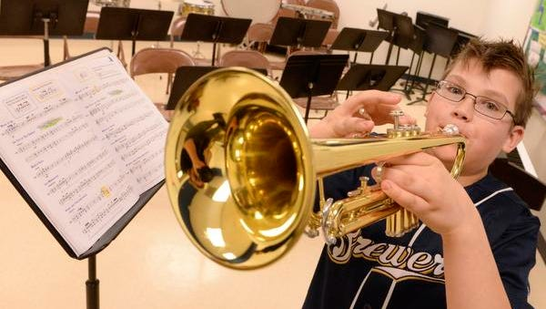 Fifth-grade trumpet player Joey O'Connor poses in the band room with his trumpet at Franklin Elementary School in Manitowoc on Wednesday. The Board of Education of the Manitowoc Public School District listed the music programs among potential cuts if referendums are not approved April 7.