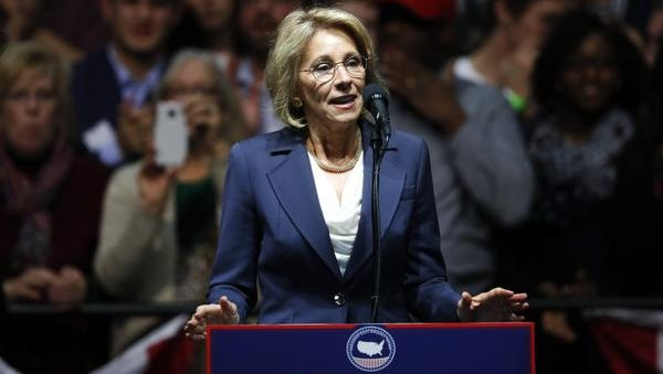 FILE - In this Dec. 9, 2016 file photo, Education Secretary-designate Betsy DeVos speaks in Grand Rapids, Mich. Charter school advocate and wealthy Republican donor Betsy DeVos is widely expected to push for expanding school choice programs if confirmed as education secretary, causing outrage among teachers' unions. But Democrats and rights activists also are raising concerns about how her conservative Christian beliefs and advocacy for family values might impact minority and LGBT students.  (AP Photo/Paul Sancya, File)