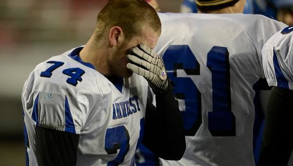Amherst's Orean Trzebiatowski (74) breaks down with emotion after Thursday's WIAA Division 5 state football championship game against Lancaster at Camp Randall Stadium in Madison. Evan Siegle/Press-Gazette Media
