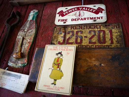 Historic items sit on a wagon bed inside the Pewee Valley Town Hall Museum. June 27, 2014