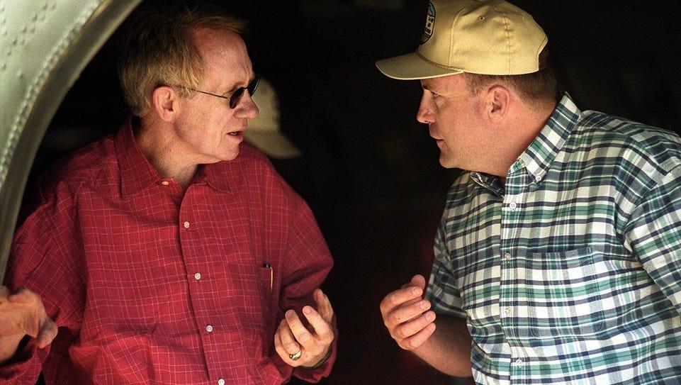 In 2001: Sen. Harry Reid, D-Nev., left, talks with