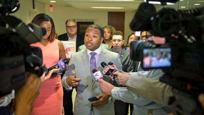 Shelby County Democratic Party Chairman Corey Strong, center, talks about a recent decision by the Shelby County Election Commission to reduce some early voting to one location at the Memphis Agricenter during a news conference June 27, 2018, outside the Shelby County Commission chamber.