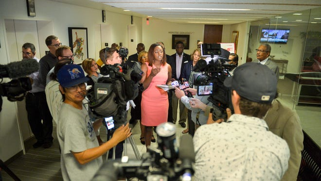 Tennessee Young Democrats President London Lamar (center) talks about recent action by the Shelby County Election Commission to reduce some early voting to one location at the Memphis Agricenter during a press conference outside the Shelby County Commission chamber on June 27, 2018.