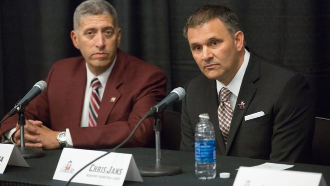 Chris Jans, right, was introduced on Monday as the 26th New Mexico State men's basketball coach at the Pan American Center. Athletics Director Mario Moccia, left, introduced Jans.