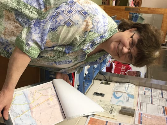 Meals on Wheels client administrator shows a delivery
