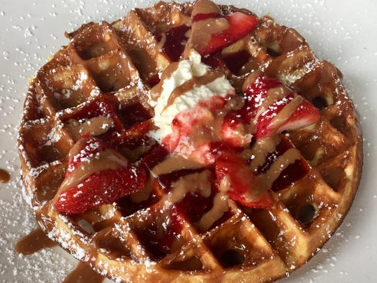 Wolf Peach, 1818 N. Hubbard St., tops its Belgian waffle with hazelnut butter, strawberry jam and whipped cream.