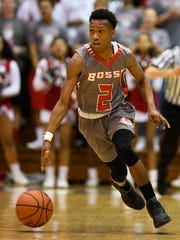 Bosse's Mekhi Lairy brings the ball down court as the Evansville Bosse plays Crispus Attucks in the Boys' Semi-State Basketball Tourney at Seymour High School Saturday, March 18, 2017.