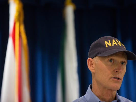 LEDE_0906_GOV SCOTT 01