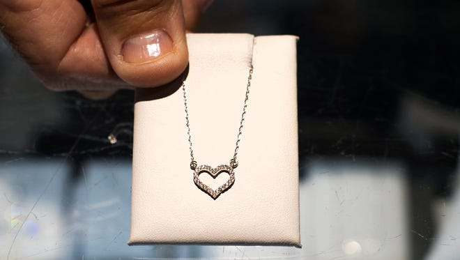 A sterling silver heart necklace for sale is seen at American Jewelry and Loan in Detroit on Feb. 1.