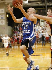 Sawyer Pauly, shown playing for Covington Catholic in 2012, is the lone senior on Thomas More College's men's basketball team.