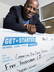 Lloyd Reshard, CEO of Cognitive Big Data Systems, poses with the $5,000 check from Get Started Pensacola at his office in Pensacola on Wednesday, November 9, 2016.  Cognitive Big Data Systems was selected the winner of the 2016 Get Started Pensacola event, presented by Cox Business.