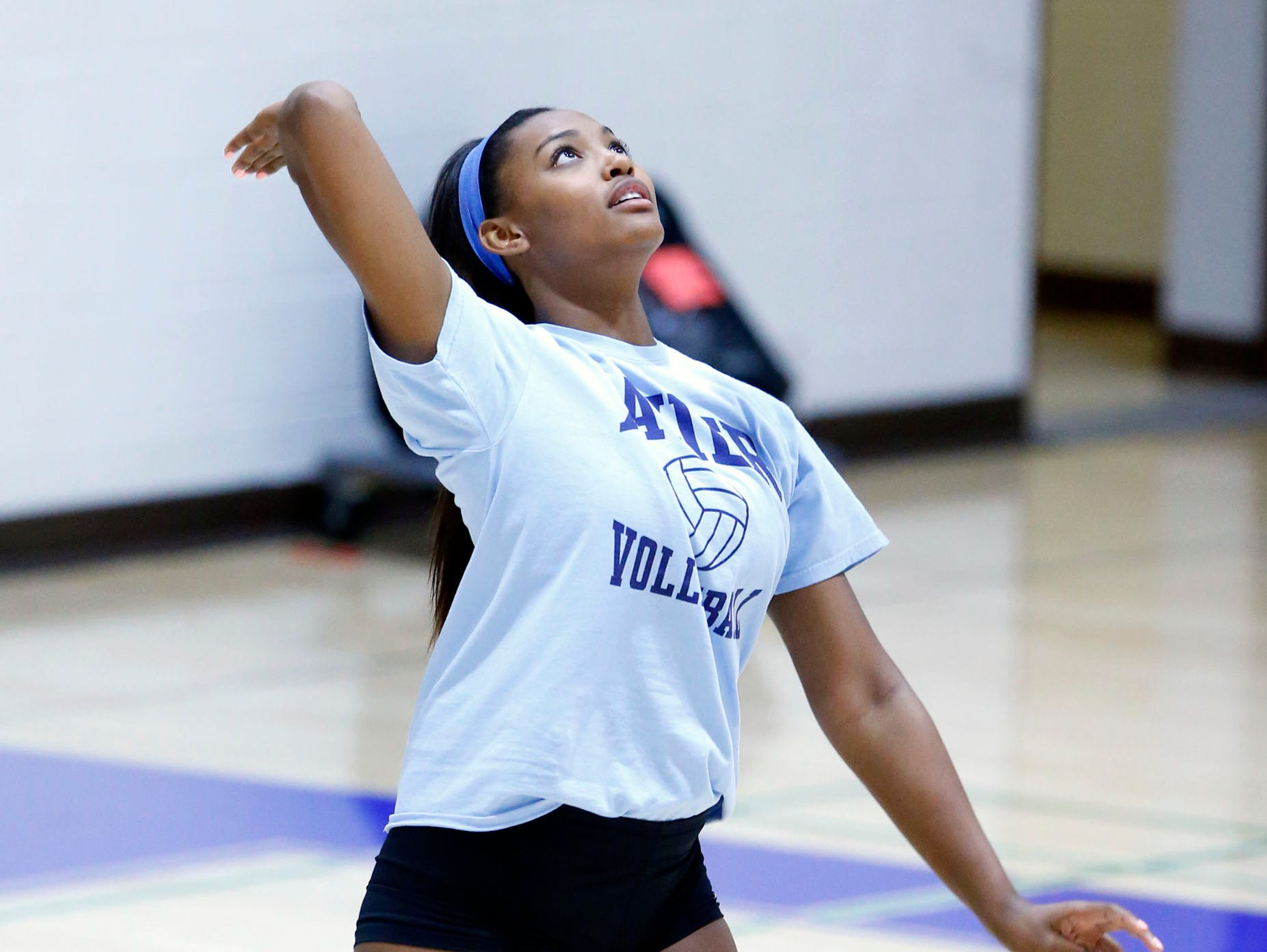 Phoenix Xavier volleyball player Khalia Lanier serves on Wednesday, Sept. 2, 2015, in Phoenix.