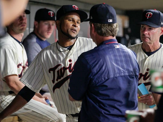 Minnesota Twins' Ervin Santana, center left, talks