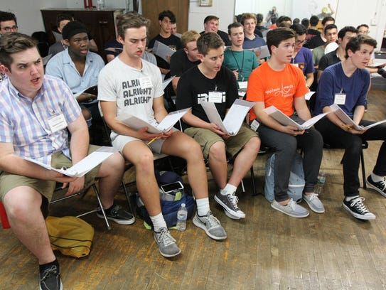 Seamus Foley, left, rehearses with other high schoolers