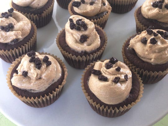 """Chocolate Surprise Cupcakes with Espresso Frosting: Tell your guests after dessert what the """"surprise"""" stands for."""