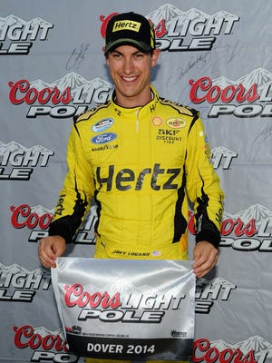 Joey Logano poses with the Coors Light Pole Award after qualifying first for the Buckle Up 200 Saturday at Dover International Speedway.