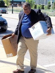 Dr. Owens delivers boxes containing the drug Narcan