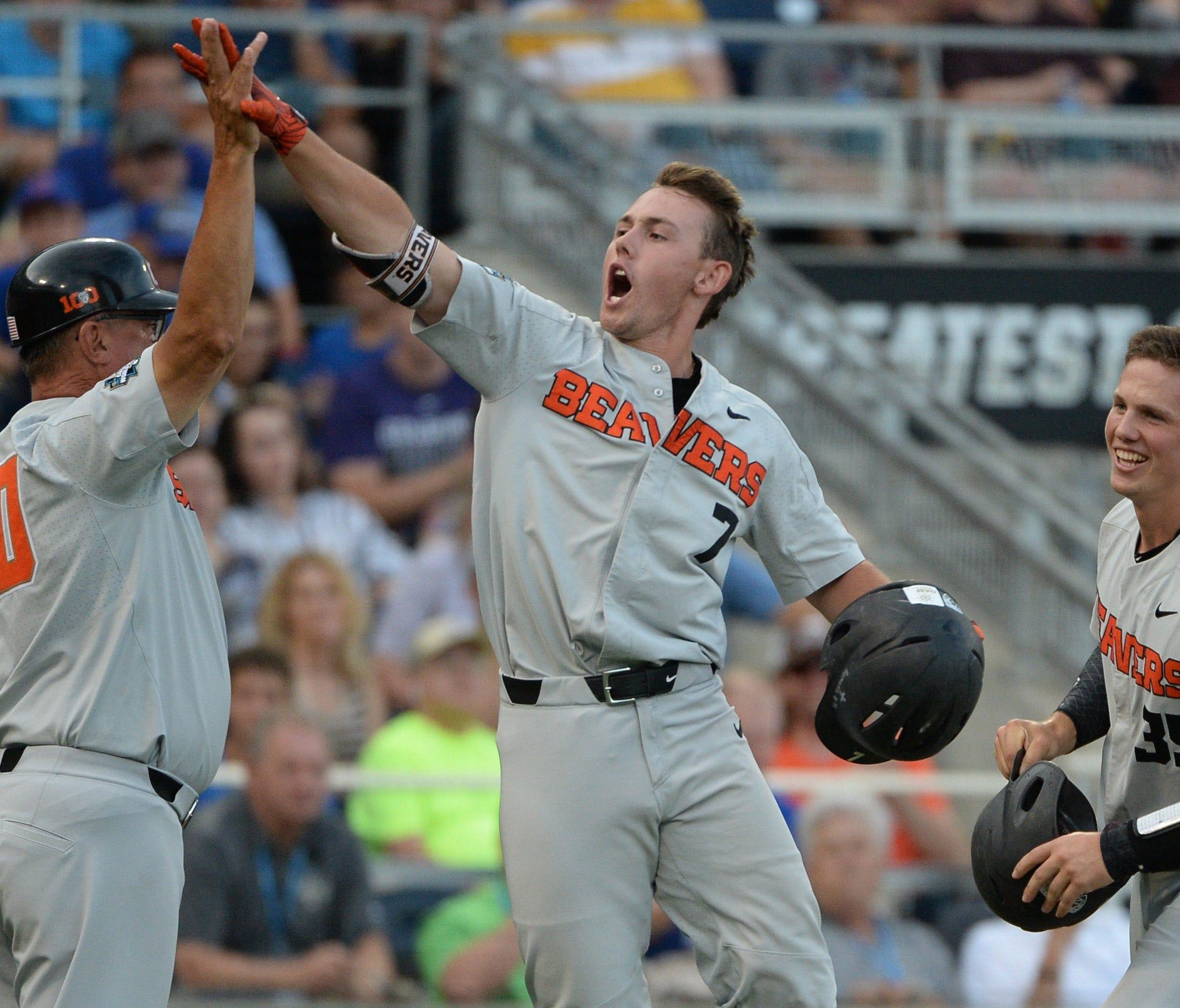 Tyler Malone (7) celebrates third-inning three-run homer.