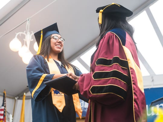 A Cumberland County College graduate receives her diploma