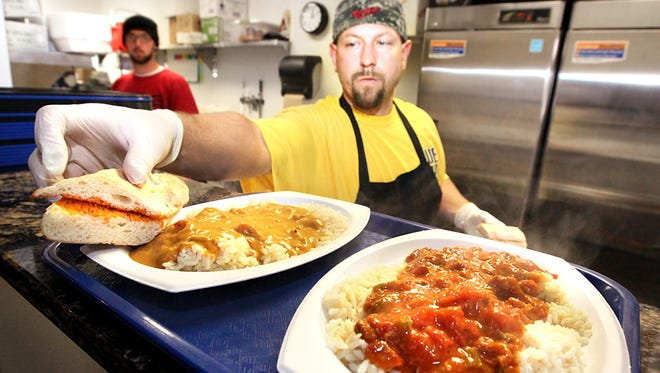 Brian Mercer served up some hot lunch specials — including Chili Cheese etouffee with crawfish (right) and Drunken Chicken — within the Yats at 885 Massachusetts Ave.