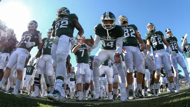 Michigan State Spartans take the field prior to a game Oct. 8, 2016.