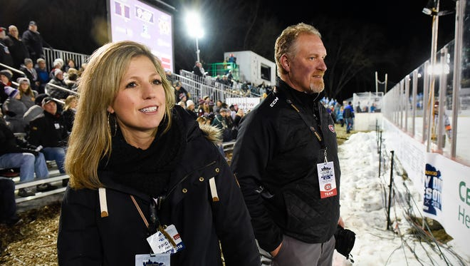 Amy Rud and her husband Eric, St. Cloud State woman's hockey coach, watch their daughter play Friday, Jan. 19, during Hockey Day Minnesota at Lake George.