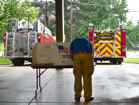 A man casts his vote in the 2018 primary at Fire Station