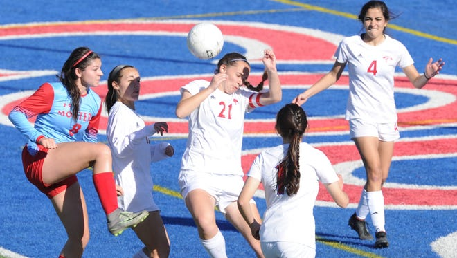 Cooper's Savannah Gregory (21) blocks a shot by Lubbock Monterey's Breeana Gamueda (8) while teammates Monica Boyes (11), Kristan Atkinson (4) and Jenna Morris look on. Monterey won the District 4-5A game 3-1 on Tuesday, March 20, 2018 at Shotwell Stadium.