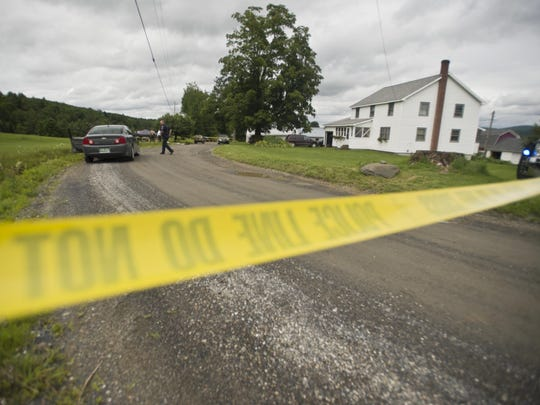 Investigators work the scene of a shooting in Westford