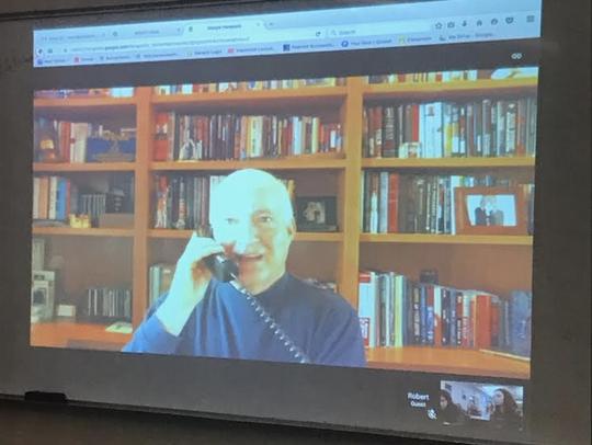 Bob Hood communicates with Stephanie Woit's English
