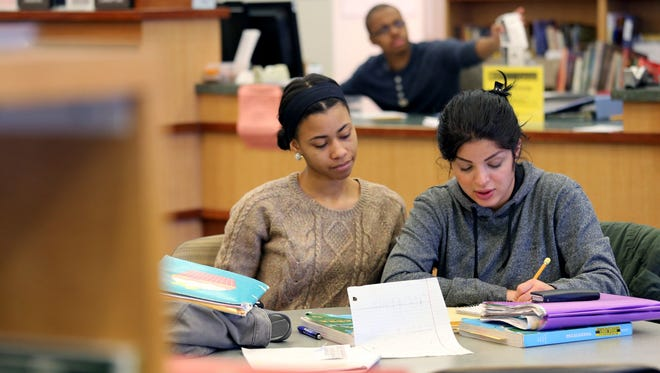 Briana Harrison,19 of Romulus studies Algebra with Dalia Alshemairy, 24, of Westland at Bradner Library at Schoolcraft College in Livonia.