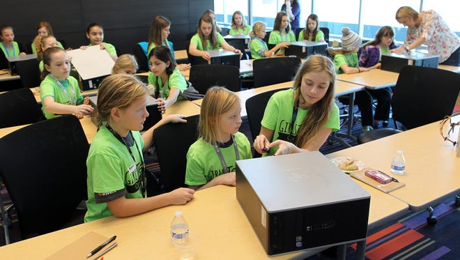 Young girls work in groups to learn about how a computer works at an Iowa Tech Chicks event at the Kirkwood Regional Center on Friday, Nov. 13, 2015.