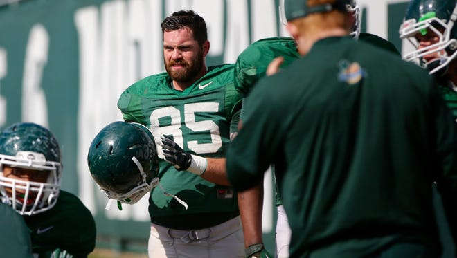 Michigan State defensive end Evan Jones practices in East Lansing on Tuesday, April 12, 2016.