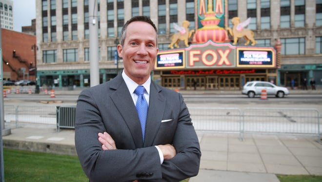 Christopher Ilitch of Ilitch Holdings, Inc. stands in front of the Fox Theatre marquee, during the relighting event in Detroit on Oct. 15, 2015.