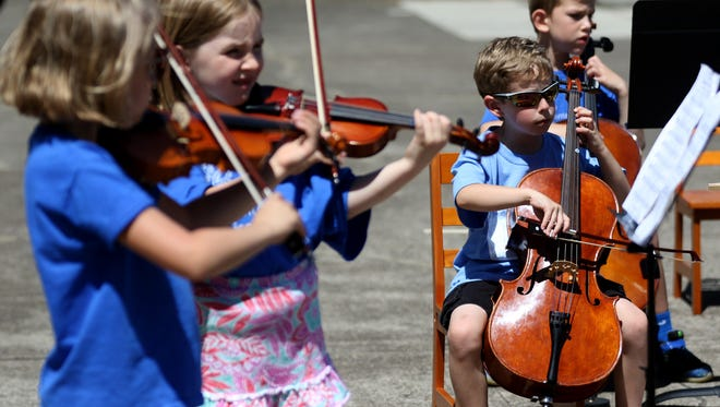 The Montessori Discovery Center String Orchestra performs, part of Make Music Day, at the Oregon State Capitol in Salem on Tuesday, June 21, 2016. More than 725 cities in more than 120 countries are participating in the free, outdoor music performances on the summer solstice.