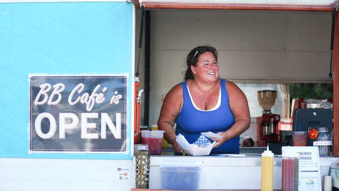 Ginger Murphy calls out an order at a soft opening for the BB Cafe food truck on Friday, Aug. 5, 2016. Murphy, the truck's owner, is reopening the Blueberry Cafe in food truck form after the original restaurant was closed in 2002.