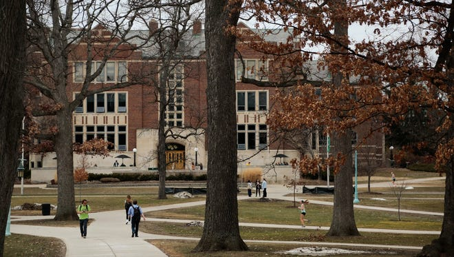 Students walk through the Michigan State University campus in East Lansing in in March, 2015.
