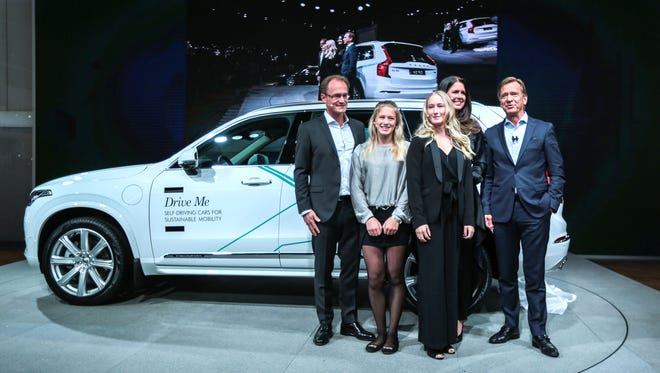 Hakan Samuelsson, CEO and President of Volvo, far right, poses for a photo with the Hain family from Gothenburg, Sweden, during the 2017 North American International Auto Show held at Cobo Center in downtown Detroit on Monday, Jan. 9, 2017. The family were chosen to be the first to take part in a real-life autonomous drive research program using real cars in traffic.