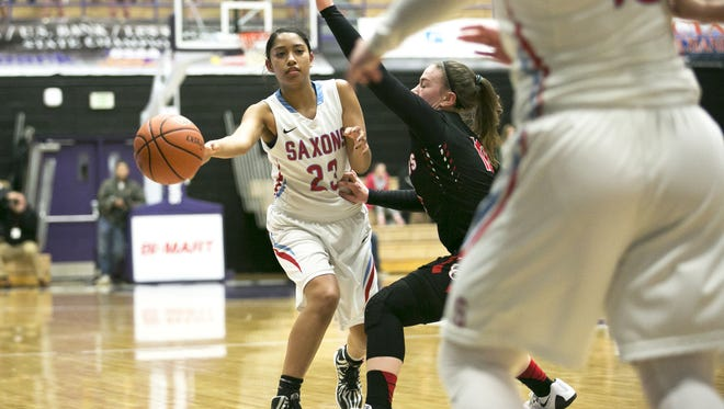 South Salem's Dani Harley (23) passes to teammate Jordan Woodvine (10) in a game against Oregon City in the first round of the OSAA Class 6A state tournament on Wednesday, March 9, 2016, at the University of Portland. South Salem defeated Oregon City 46-30.
