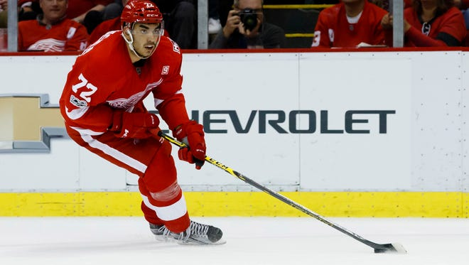 Red Wings center Andreas Athanasiou (72) skates with the puck in the second period of the Wings' 2-1 overtime loss Friday at Joe Louis Arena.