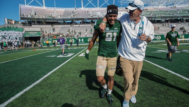 CSU receiver Bisi Johnson walks off the field with coach Mike Bobo following the Rams' 58-27 win over Oregon State on Aug. 26 at Colorado State University Stadium. Johnson's work ethic, Bobo said, is 'the standard' that wants all the Rams to adopt.