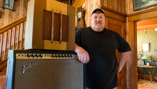 Chris Troy in his home with a 1946 Gibson BR4 amp that once belonged to steel guitar player Whitey Cutcher and a 1971 Fender Twin Reverb amp that belonged to keyboardist Johnny Needham. Troy recently completed a documentary about the music scene in the Blue Water Area.