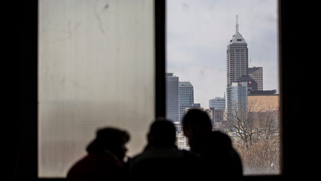The view of downtown from the fourth floor is seen during a sold-out open house held by Indiana Landmarks at the former Ford manufacturing plant in Indianapolis, Saturday, Nov. 11, 2017. From 1915 to 1932, the plant produced almost 600,000 automobiles. TWG Development now owns the building, which will become a living and retail space.