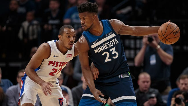 Timberwolves forward Jimmy Butler (23) dribbles in the first quarter against the Pistons guard Avery Bradley (22) on Sunday, Nov. 19, 2017, in Minneapolis.