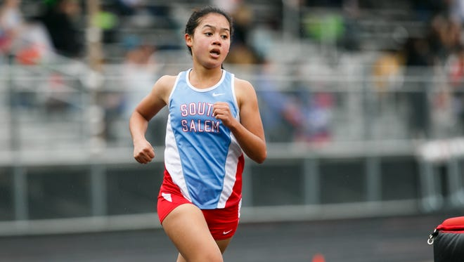 South Salem's Anna Chau runs the 1,500 meter at a dual meet on Wednesday, March 21, 2018, at North Salem High School.