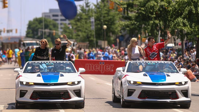 IndyCar drivers ride in the annual IPL 500 Festival Parade.