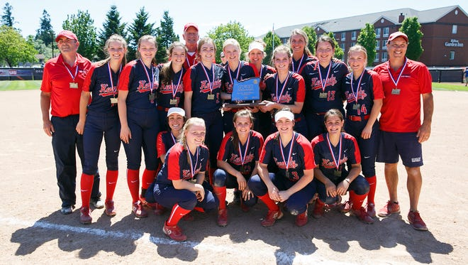 The Kennedy softball team holds their first place trophy at the OSAA Class 2A/1A State Championship Game on Friday, June 1, 2018, in Corvallis. The Trojans won 10-0 after five innings against Pilot Rock/Nixyaawii.